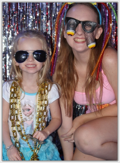 Two Girls Wearing Silly Glasses